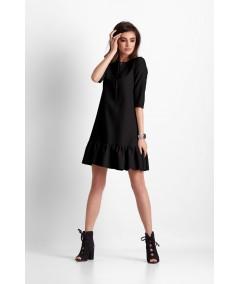 trapezowa, czarna sukienka z falbanką