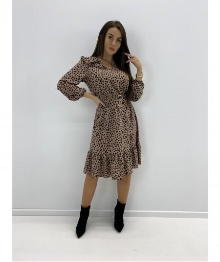 Elegancka sukienka za kolano z falbanką